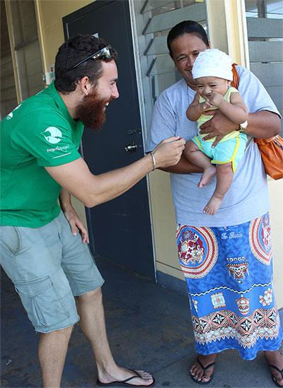 A nutrition volunteer laughs with a local during a nutrition outreach in Fiji