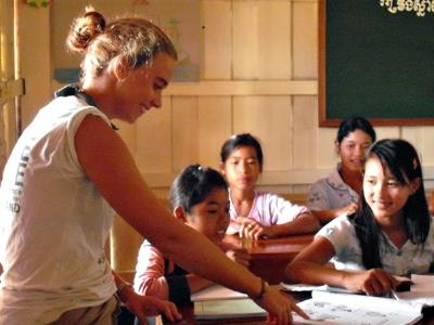 Projects Abroad volunteer teaches local children in a classroom in Cambodia