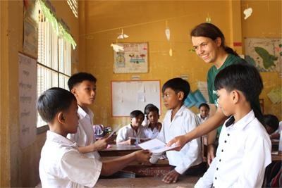 A Diving & Marine Conservation volunteer in Cambodia giving extra lessons at a local school