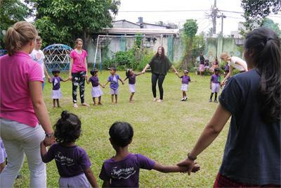 Projects Abroad High School Care and Community volunteers play games with children at a pre-school in Colombo, Sri Lanka
