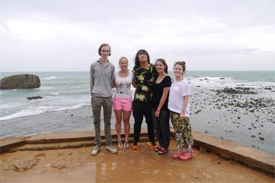 A group of Projects Abroad volunteers in Sri Lanka enjoy their free time on a beach