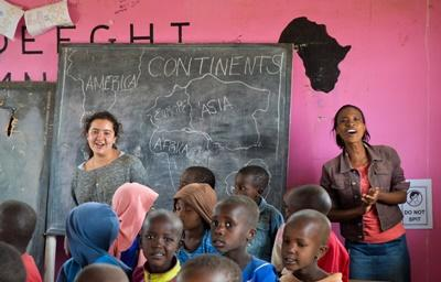 A Projects Abroad Teaching volunteer sings with a class of children at a school in near Arusha in Tanzania