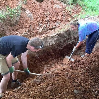 Long term building volunteers digging the foundations for new earthquake proof classrooms at a primary school in Nepal