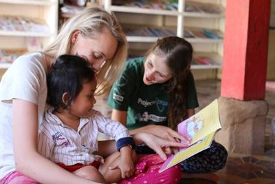 Projects Abroad Care and Community volunteer reads to the children at her placement in Sri Lanka