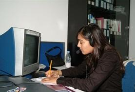A Business intern works at her desk at her volunteer placement in China.