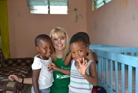 A volunteer spends time with children at one of our childcare placements in Jamaica.