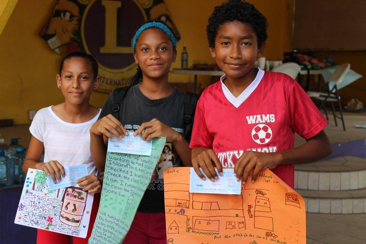 Children at a Belize Care Placement receive certificates for work well done