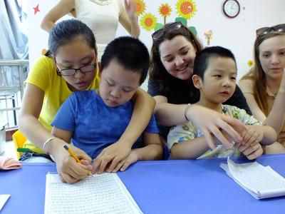 Projects Abroad volunteers with children at a Care project in China