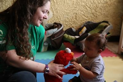Projects Abroad volunteer plays with a baby at her Care placement in Costa Rica