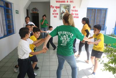 Projects Abroad Care volunteer plays a game with her students at a care placement in Guadalajara, Mexico