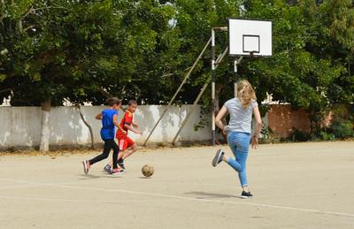 A Projects Abroad volunteer plays football with two boys at a Care centre in Morocco.