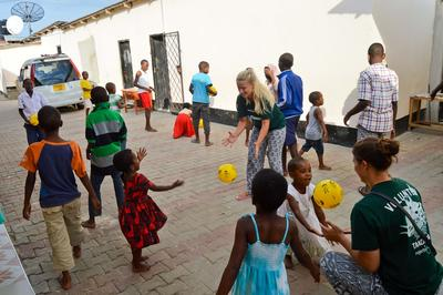 Projects Abroad volunteers play with children at an orphanage on a Care Outreach