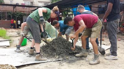 Projects AbroadBuilding volunteers assist with the building of a classroom in Kathmandu.