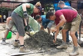 A group of volunteers working on a Building project in Nepal, constructing and repairing houses over their Christmas vacation.