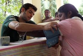 A Medicine volunteer in Sri Lanka measures a woman's blood pressure as part of a screening outreach over the Christmas holidays.