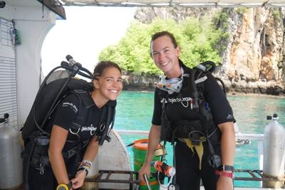 Conservation volunteers prepare to dive to conduct fish surveys