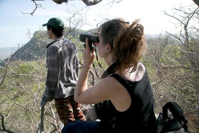 Swiss volunteer, Mina Guillaume-Gentil watches for birds with conservation staff member, Eduardo Artavia, as part of the fixed-point surveys undertaken by conservation volunteers