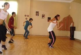 A Dance volunteer holds a dance class rehearsal with local students in Romania.