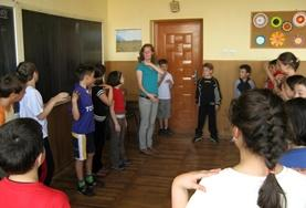 A Drama volunteer provides guidance and coaching to local school students in a Romanian community.