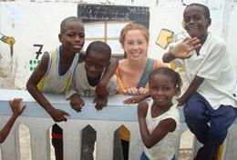 A High School Project Building & French volunteer spends time with the children at the school in Senegal where she is doing renovation work.