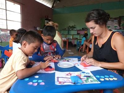 Projects Abroad Care volunteer busy works with young boys in Ecuador