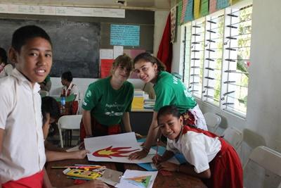 Projects Abroad volunteers work on a project with primary school students at a school in Apia, Samoa
