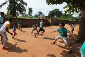 High School Project volunteers play a game with local children in Togo to help with their physical development and teamwork.