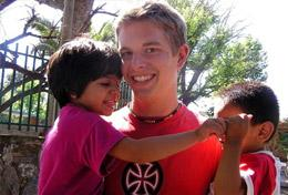 A High School Project Care & Spanish volunteer works with children in Argentina to help with their development.