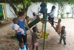 A volunteer spends time working with children in a playground at her Care & Community placement in Togo.