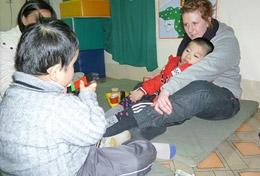 High School Project volunteers assist with caring for disabled children in Vietnam.