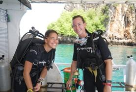 Conservation & Community volunteers prepare for a survey dive to monitor marine life off the coast of Thailand.