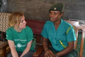 A Human Rights High School Project volunteer interviews a local Ghanaian official as part of her research.
