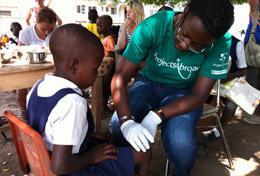 A Medicine volunteer gains experience doing health screenings during her high school internship in Ghana.