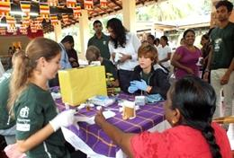 High School Project Medicine volunteers in Sri Lanka assist during a screening outreach.