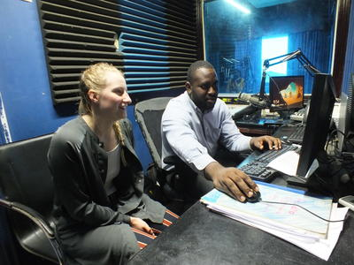 Projects Abroad Journalism volunteer is being taught how to edit recordings for radio play