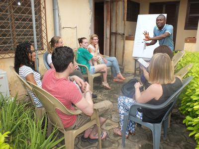 Projects Abroad volunteers take part in an Ewe local language lesson at the office in Togo