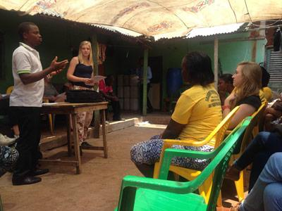 Projects Abroad Law and Human Rights intern assists at an outreach programme in Ghana