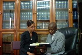 A local lawyer explains the details of Ghanaian law to an intern volunteering abroad.