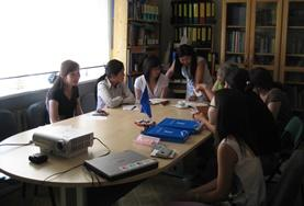 A group of Law interns discuss the details of a case during a meeting at their placement in Mongolia.