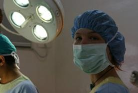 A Dentistry intern prepares to observe dental surgery carried out by a medical professional in Nepal, Asia.