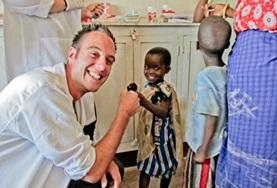 A Dentistry intern gives a child a high-five after a successful dentistry check-up at a hospital in Tanzania.