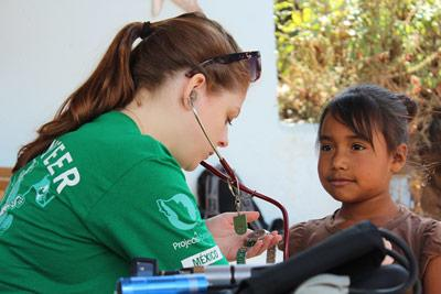 Medical volunteer provides health checks on outreach in Mexico