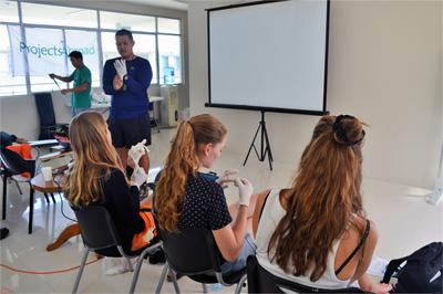 Projects Abroad Medical volunteers view a presentation at their placement in the Philippines, Asia