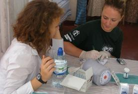 Midwifery volunteers doing a medical internship in Sri Lanka assist with preparing medication in the maternity department of a hospital.