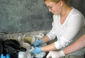 A Midwifery intern assists with preparing medication for newborn babies at a hospital in Togo.