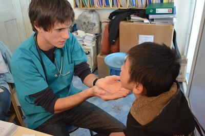 Projects Abroad Nursing volunteer assesses a young boy at his placement overseas in Mongolia