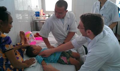 Projects Abroad Vietnam medical volunteers treat young boy in hospital