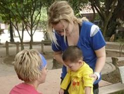 A medical volunteer works on strengthening a child's leg muscles at our Physiotherapy internship in Vietnam