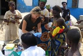 A Public Health intern conducts a medical screening outreach in a local community in Ghana.