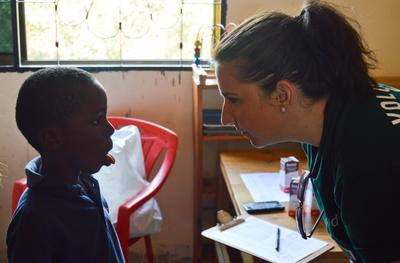 A Projects Abroad speech pathology volunteer works with a young boy